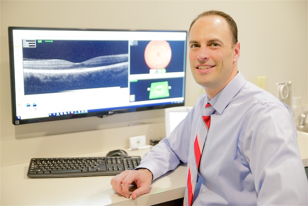 Dr. Snyder reading results from Optical Coherence Tomography (OCT) scan